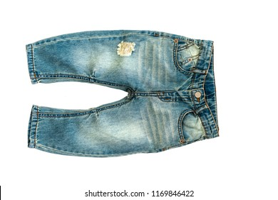 Children's jeans isolated on white background for spring and autumn wardrobe/ Baby clothes/ Close-up/ Top view/ Flat lay