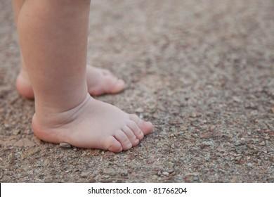 Children's legs walk along track