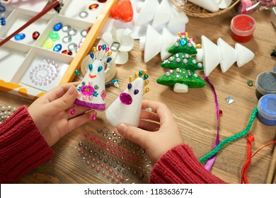 Childrens making decorations for new year holiday. Painting watercolors. Top view. Artwork workplace with creative accessories.