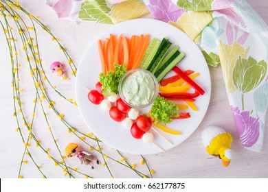 Children's menu in the restaurant. A healthy, nutritious, balanced diet for children. Sliced vegetables. Crispy cucumbers, carrots, sweet peppers. Shaped with caprese