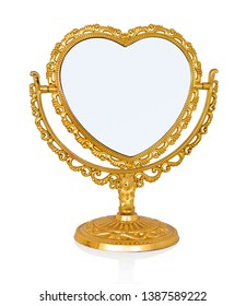 Children's mirror toy for small dressy girls. Isolated on white background with shadow reflection. Small hand-glass which looks as made of gold, for little children. Childrens mirror on white bg.