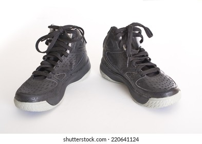Children's modern high-top black leather and mesh basketball shoes,  sneakers isolated on white
