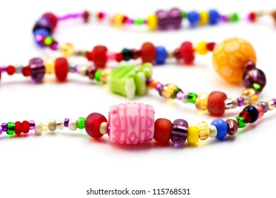 Children's necklace of beads and plastic.