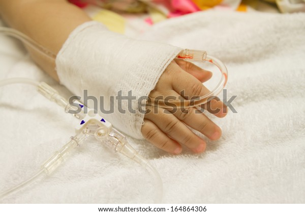 Children's patient  in the hospital with saline intravenous (iv) drip