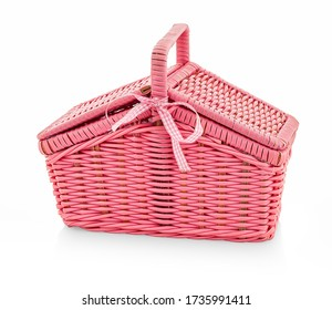 Children's picnic wicker basket - toy. Basket for children's picnic things. Isolated on white reflective background with shadow reflection. With clipping (vector) path. Pink basket toy on white bg.