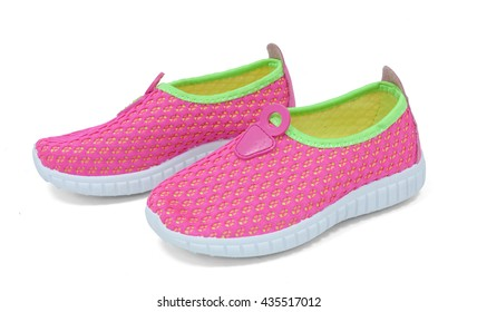 Children's pink trainer shoes on white background