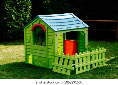children's plastic house on the lawn
