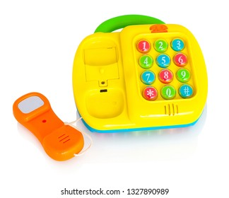 Children's plastic toy phone. Isolated on white background with shadow reflection. With clipping path. Childish telephone with buttons which make sounds. Educational telephone for little children