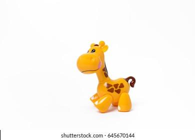 Children's plastic toy - yellow giraffe on a white background.