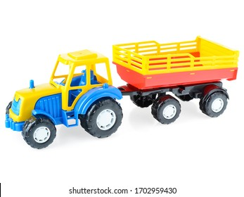 Children's plastic truck with a trailer on a white background, close-up. Bright, toy car for children. Educational games for children. Children's leisure and games.