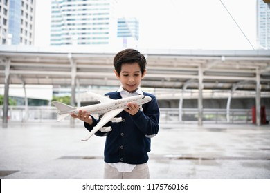 Children's play concept. The boy is playing with toys. Boy playing toy in the city.