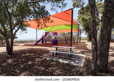 Childrens Play ground equipment covered by a large shade sail in a park. Hervey bay Queensland, Australia