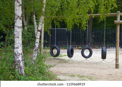 Children's Playground Equipment With Four Hanging Rubbery Tyre Swings