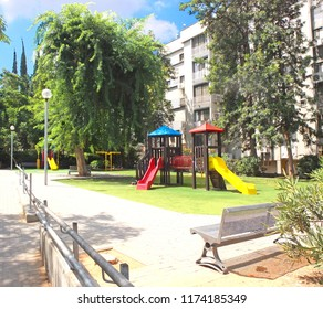 Children's playground in a green garden in the city of Holon in Israel.