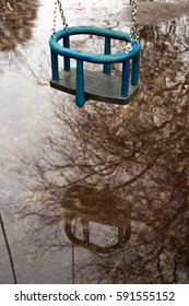 Childrens playground with little swing got flooded