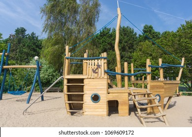 Children's playground with a wooden boat to climb