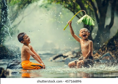 Childrens playing in the river