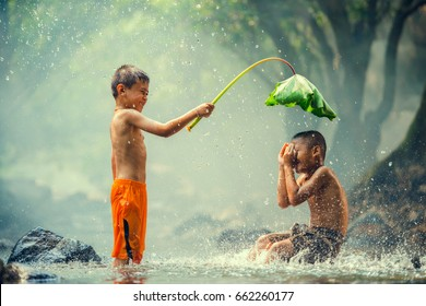 Childrens playing and splashing in the river