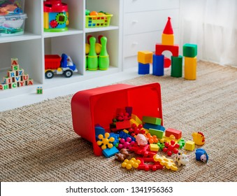 Children's playroom with plastic colorful educational blocks toys. Games floor for preschoolers kindergarten. interior children's room. Free space. background mock up