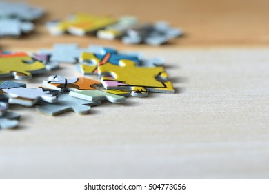 Children's puzzles on a wooden background close up