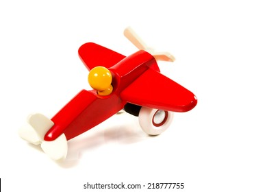 Children's red plane with a propeller on wheels isolated on white background