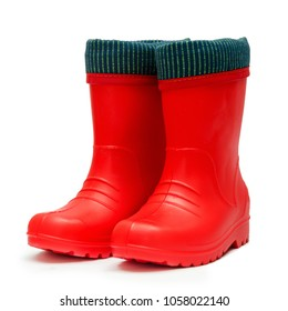 Children's red rubber boots with cuff crude rainy weather isolated on white background