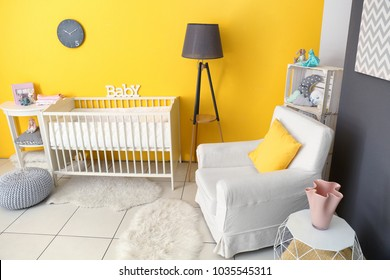 Children's room interior with crib and comfortable armchair
