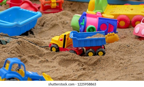 Children's Sandbox. Set Of Colored Plastic Toys On The Sand,