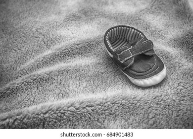 Children's shoes on the blanket