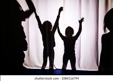Children's silhouette. The concept of child protection. Children's performance in the theater.