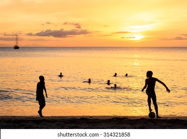 Childrens silhouette playing soccer at Tarrafal beach in Santiago island in Cape Verde - Cabo Verde