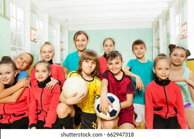 Children's soccer team in school sports hall