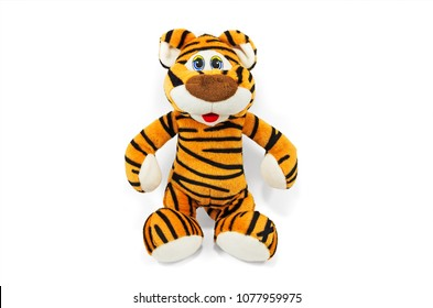 Children's soft toy tiger on a glossy sheet and white background