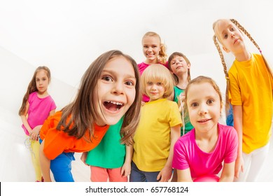 Children's sports team with young female coach