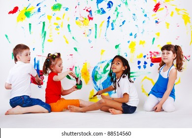 Children's team painting on the wall