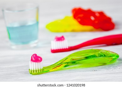 children's toothbrush oral care on wooden background