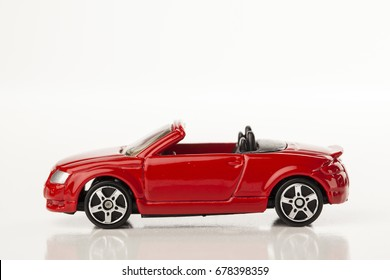 Children's toy car isolated on white background