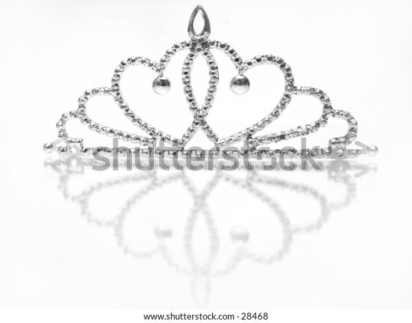 Children's toy crown on reflective background