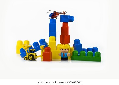 Children's toy, the designer, cubes, a tractor, the helicopter