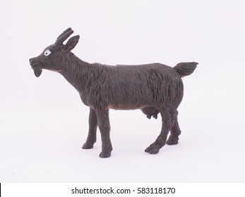 children's toy goat on a white background