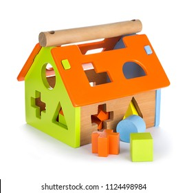 Children's toy house isolated on white background. Educational toys.