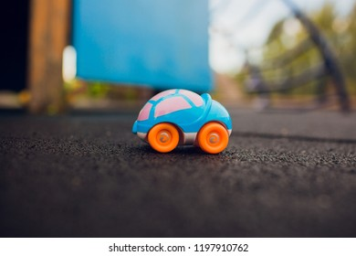 children's toy, on the asphalt, child lost a plastic machine