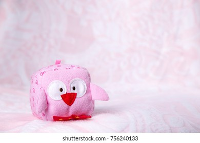 Children's toy on a pink background