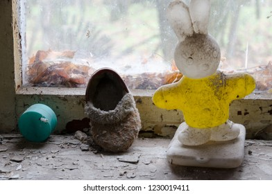 Children's toy and shoes on windowsill in abandoned kindergarten in destroyed village of Kopachi (10-km Chernobyl NPP alienation zone), Ukraine