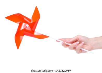Children's toy windmill in hand on white background isolation