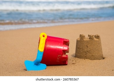 Children's toys at the beach on a sunny day