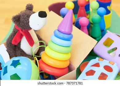 Children's toys in a cardboard box.