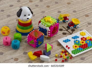 children's toys on the carpet