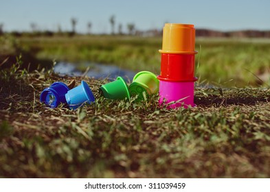Children's toys on the grass by the river