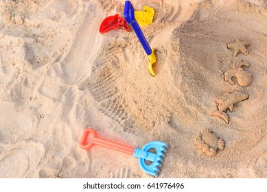 Children's toys on sand beach.